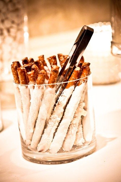chocolate dipped pretzels can be served in glass containers