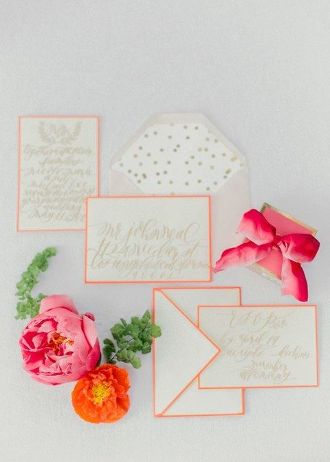 coral framed wedding stationary and a polka dot envelope