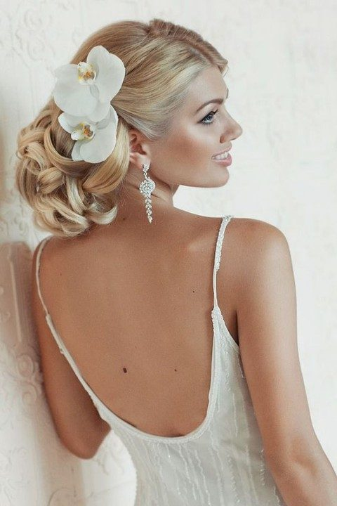 elegant curly updo with large white orchids