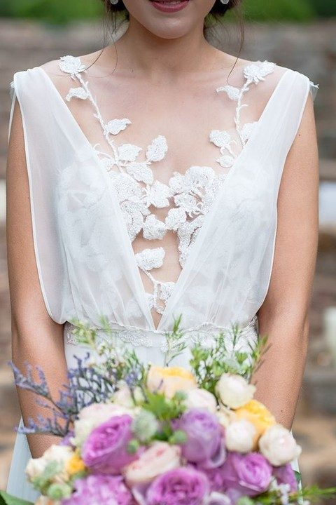 floral applique wedding dress with an illusion neckline bodice over it