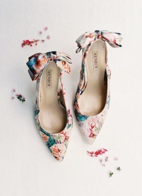 floral heels with large bows on the backs