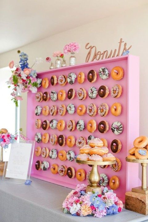 funny pink donut wall and stands