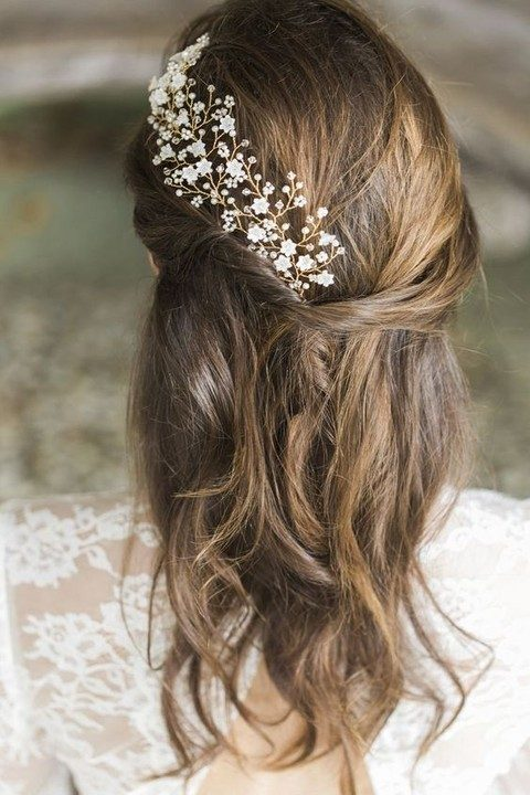 gold floral and rhinestone hair vine coming up the hairstyle