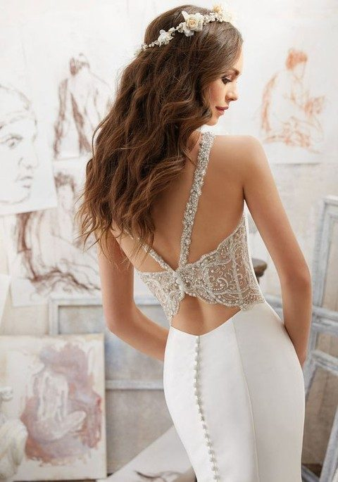 heavily beaded wedding dress with buttons on a cutout back
