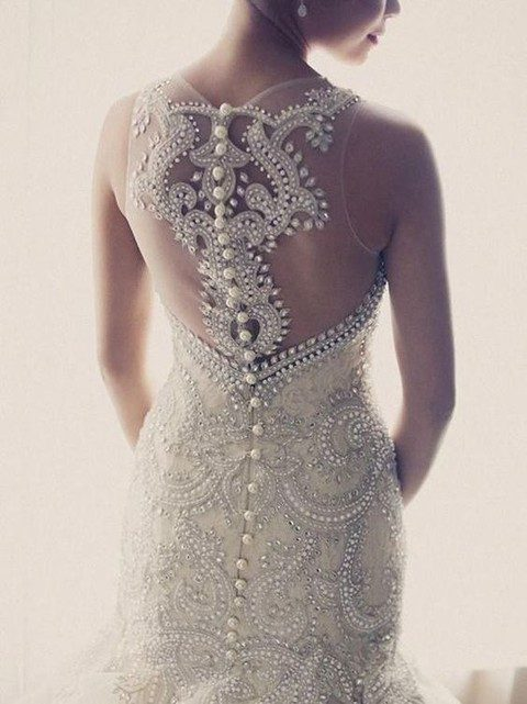 heavily jeweled wedding dress with an illusion racerback on buttons