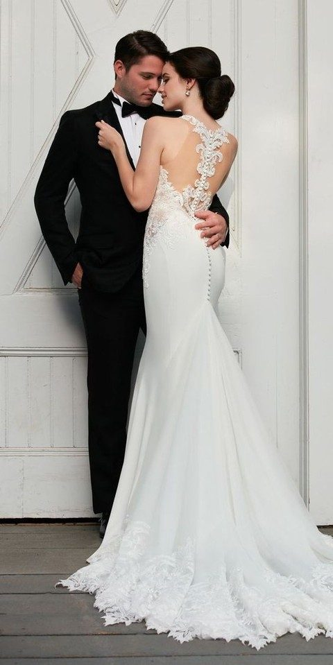 illusion racerback wedding dress with a row of buttons and a train