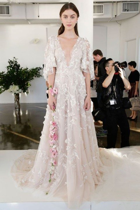 ivory plunging neckline wedding dress with floral appliques and half sleeves