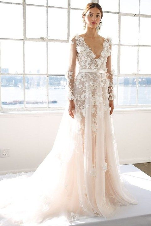 ivory plunging neckline wedding dress with floral appliques and long sleeves