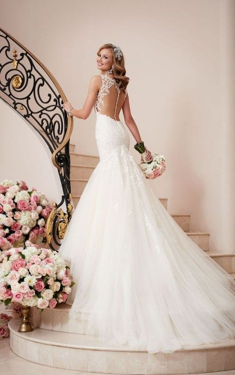 lace mermaid wedding gown with an illusion back on rhinestone buttons and a train