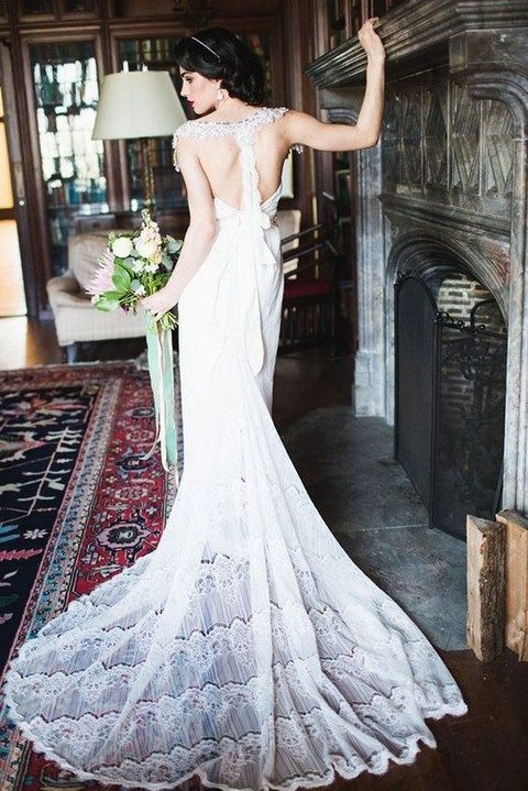 lace racerback wedding dress with a bow and a train