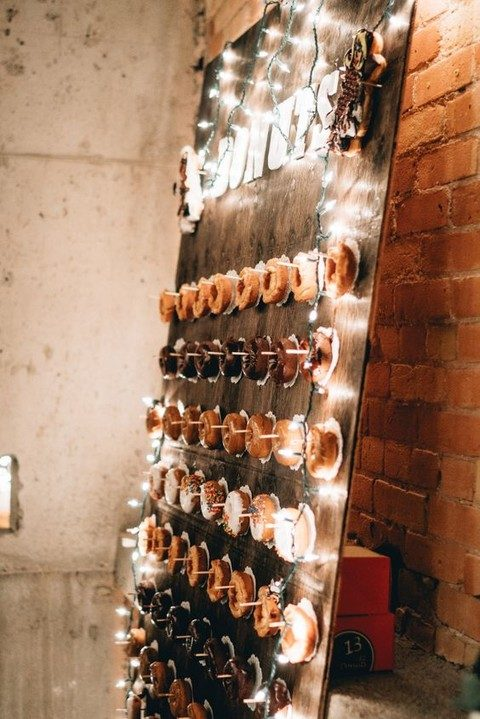 lit up donut wall is cool idea for any wedding