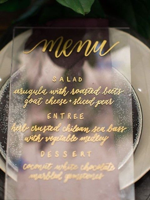 menu with gold letters and calligraphy