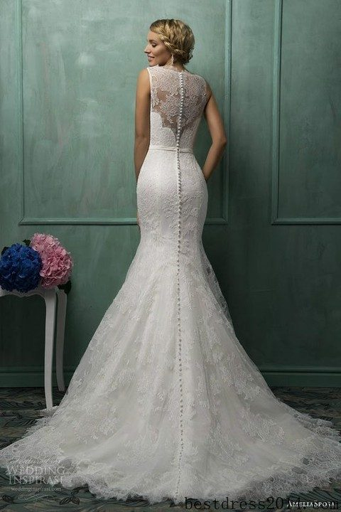 mermaid lace wedding dress with an illusion back and a row of buttons looks flawless