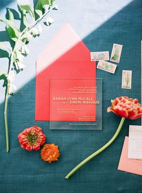 modern acrylic invites with gold letters and a colorful envelope