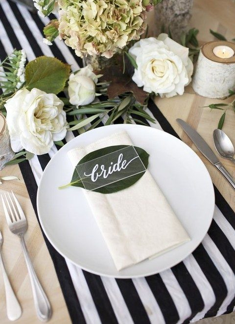 modern place card with white calligraphy