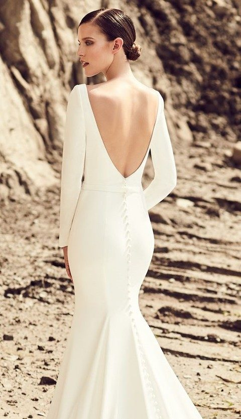Modern Plain Wedding Dress With Sleeves And A Cutout Back Ons On It