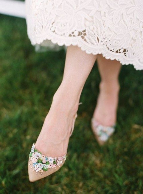 nude shoes with lots of flower appliques