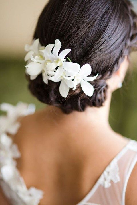 perfect wedding updo with white flowers tucked in
