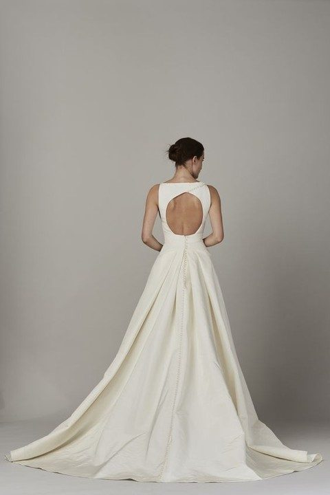 plain ivory wedding dress with a cutout back and buttons