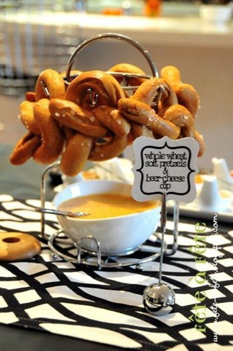 pretzels on a stand and dips under each stand