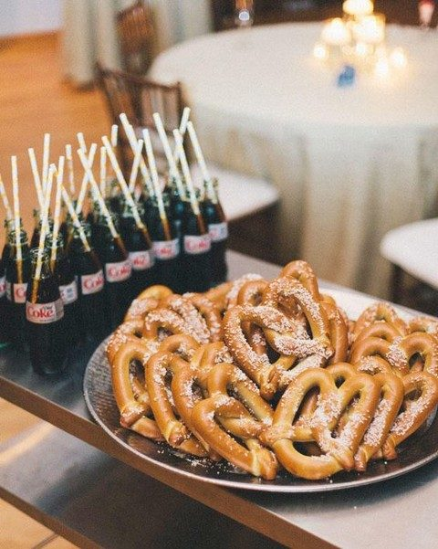 pretzels on a tray and Coke bottles are a perfect match