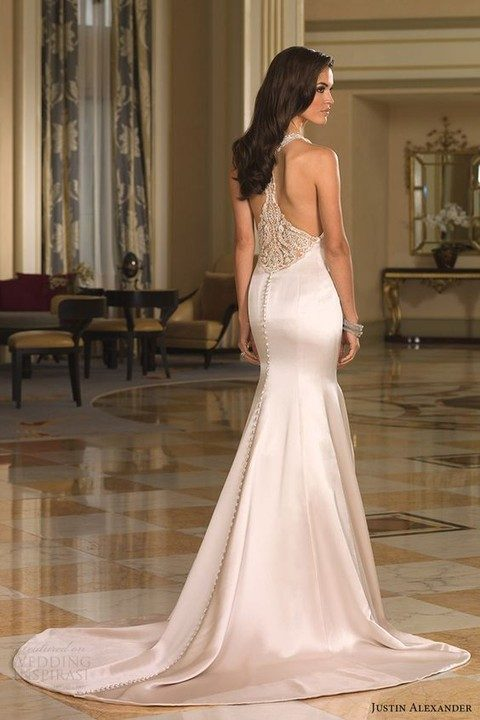 satin mermaid wedding dress with a lace beaded back and a row of buttons