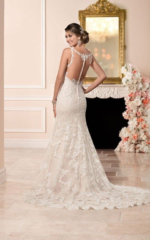 sheath wedding dress with a sheer back and a row of fabric covered buttons