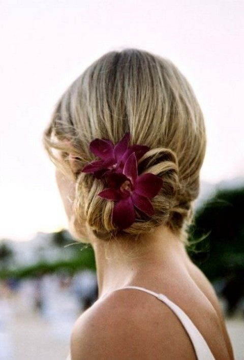 short wedding hair in an updo with purple flowers