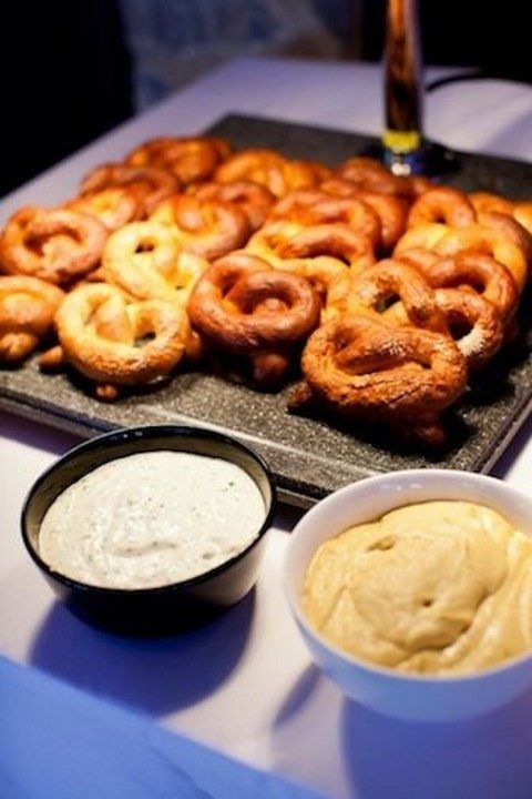 simple pretzel display on a tray and various dips