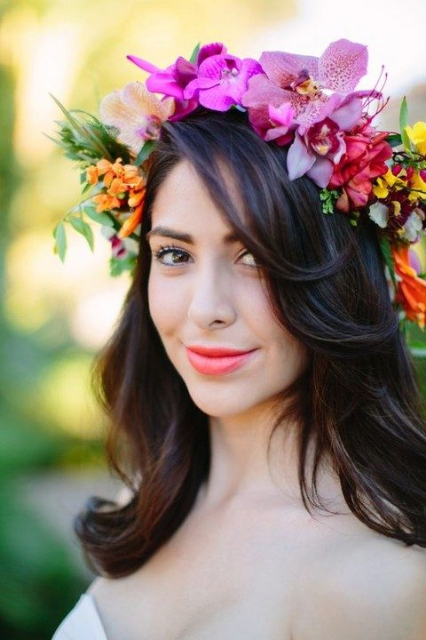 wavy shoulder-length hair with a bold tropical flower crown