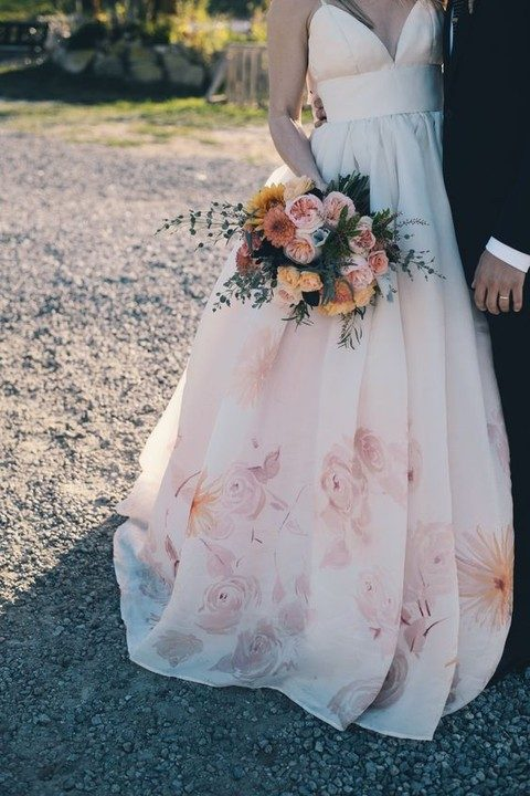 wedding dress with spaghetti sraps and a watercolor flower skirt