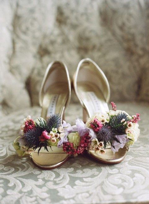 wedding heels topped with fresh blooms and thistles