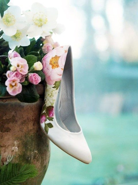 white heels with hand painted flowers on them