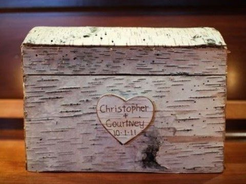 a birch box with a lid and a carved heart