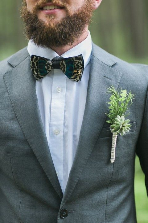a grey jacket, a white shirt, a printed bow tie