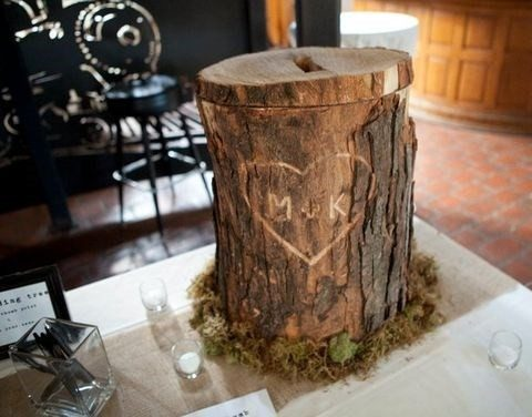 a real carved stump with moss as a card holder