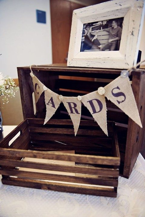 a stained crate with a burlap banner over it