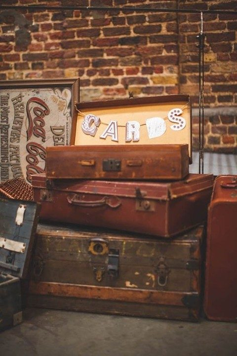 a vintage suitcase with a banner is great for a rustic wedding
