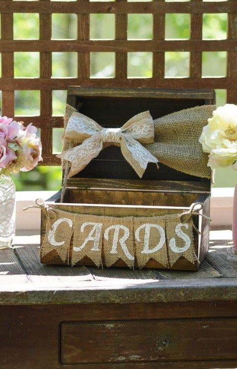 a wooden box with a burlap banner and a burlap bow
