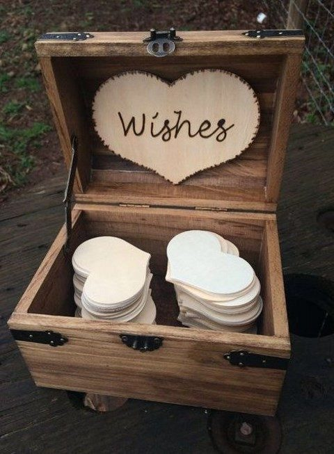 a wooden card box with a wood burnt heart