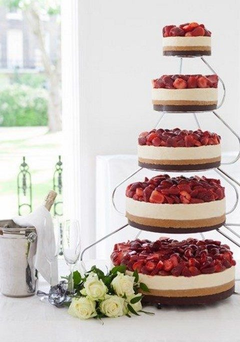 an assortment of cheesecakes topped with fresh strawberries