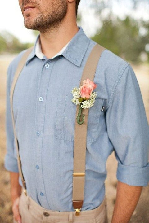 beige pants, a chambray shirt, beige suspenders and a boutonniere