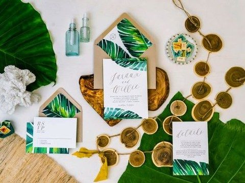 bold tropical leaf prints and kraft paper envelopes