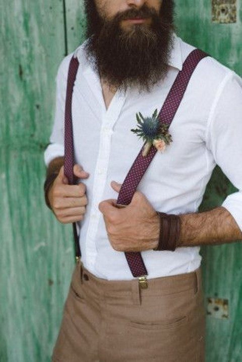brown pants, a white shirt and polka dot suspenders