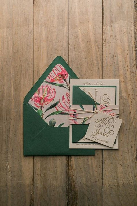 emerald envelopes and pink tropical blooms