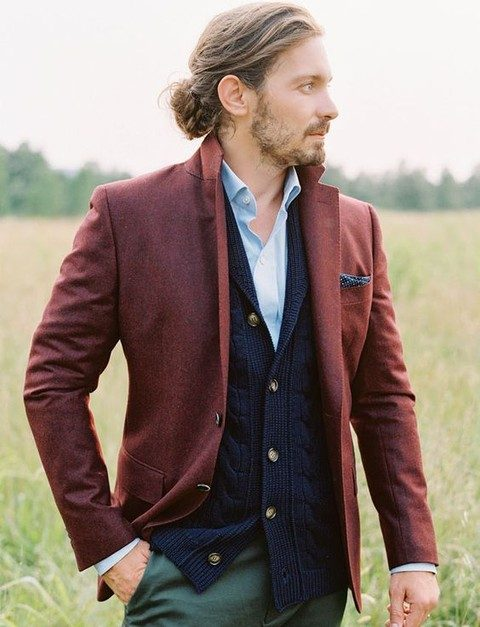 green pants, a blue shirt, a navy cardigan and a red jacket