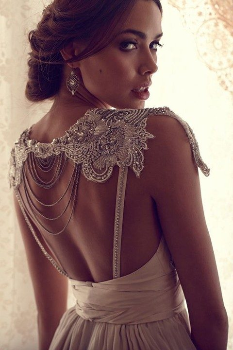 heavily beaded lace top with chains on the back