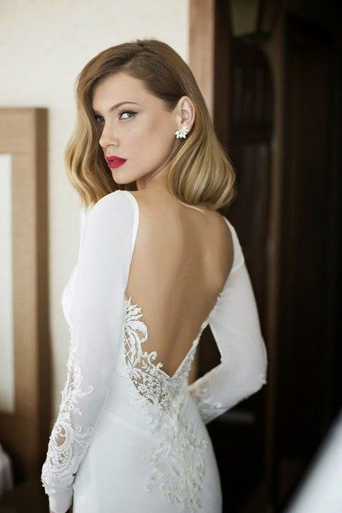 intricate lace appliques on the back and sleeves