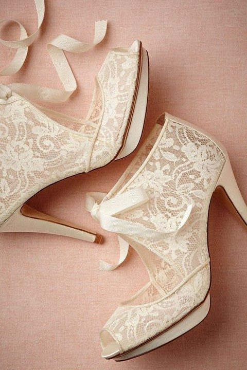 ivory lace wedding boots with peep toes, cutouts and ribbon bows