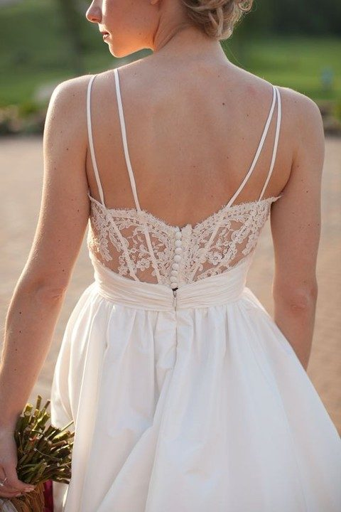 lace back detail with a row of buttons and thin straps